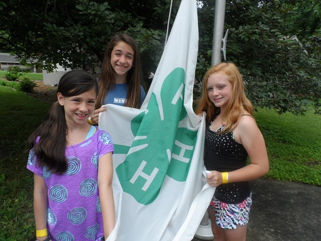 Campers get ready to raise a 4-H flag